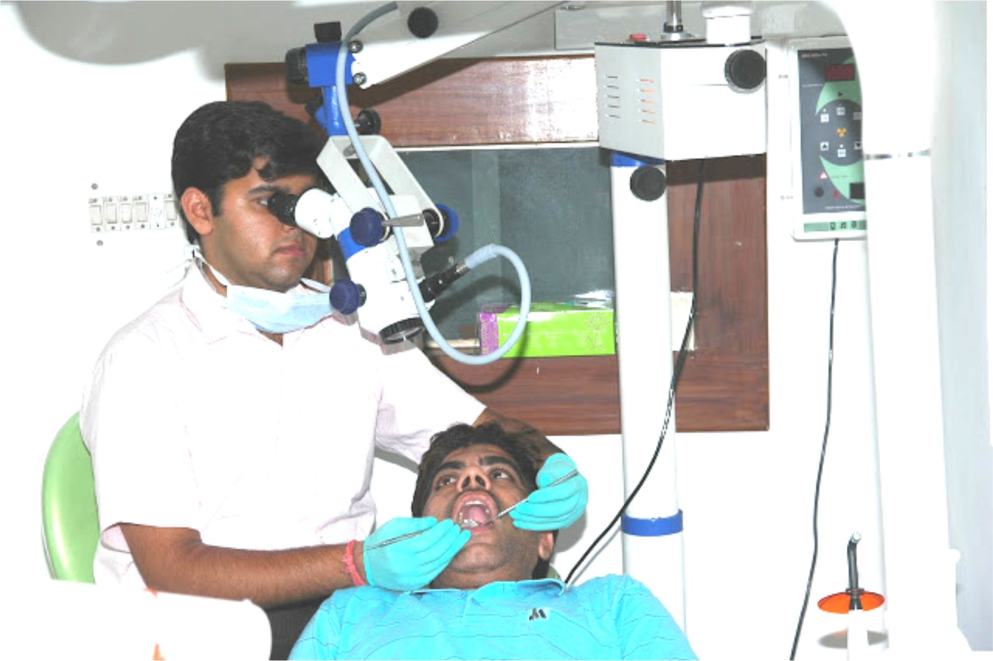 Dr. Nikhil Working on Microscope